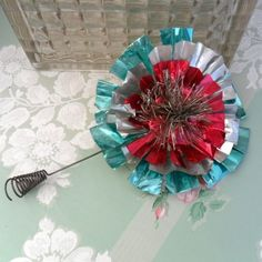 Very nice vintage retro and funky aluminum and tinsel Christmas tree topper, fab aqua, pinkish red and silver, on a coiled wire attachment. Description from pinterest.com. I searched for this on bing.com/images