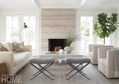 French doors flanking an indoor-outdoor fireplace open to a deck to ensure a strong connection between the living room and the outdoors. Armchairs swivel to provide comfortable viewing of the pool or, Coastal Living Rooms, Formal Living Rooms, Home Living Room, Living Room Designs, Modern Living, Modern Fireplace, Fireplace Mantle, Fireplace Design, Beach Fireplace