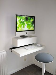 "Gérard from The Netherlands has a sleek solution for his iMac. (I'd do it as a standing desk -- Lawrene)    ""My Apple iMac obstructed our dinner table for a year. My wife did not make much of it. To please her I did a little Ikea hacking. I bought a Ludvig Laptop shelf/charging station. And a Ludvig Router/modem wall cabinet."