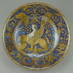 Lustred dish or piatto da pompa with a sphinx holding a shield bearing a tree ~ ca.1530 ~ Italy (Deruta) ~ Tin-glazed earthenware  Inscription Obverse on shield, VIVA ~ Courtald Art Institute