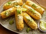 Cooking Channel serves up this Grilled Corn on the Cob with Garlic Butter, Fresh Lime and Cotija Cheese recipe from Bobby Flay plus many other recipes at CookingChannelTV.com