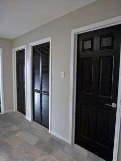 Grey walls, white trim, black doors, daltile ayers rock majestic mound tile