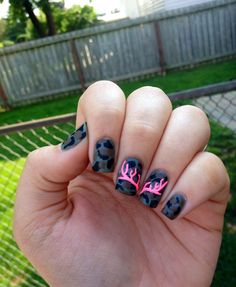 Matte camo nails with pink antlers as accent.