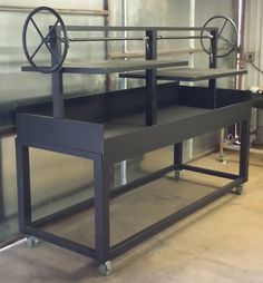 An NSF Approved 8 foot by 3 foot commercial charcoal grill by NorCal Ovenworks. Designed to cook crazy chicken.