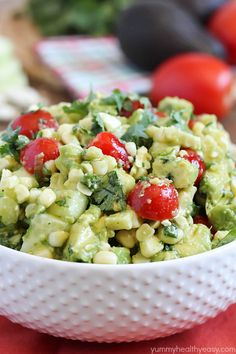 Grilled Corn Avocado Salad - delicious grilled corn mixed together with avocado, tomato, feta, and cucumber then tossed in an easy dressing. Refreshing and perfect side dish for a BBQ!
