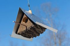 Log Quartered Birdhouses designed by  Moger Mehrhof Architects