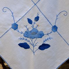 vintage  tablecloth blue and white hand embroidered appliqué. $62.00, via Etsy.