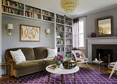 Angie Hranowski - living rooms - Madeline Weinrib Atelier Aubergine Brooke Rug, gray, walls, gray, built-ins, herringbone, tiles, beveled, mirror, pink, purple, floral, accent chairs, brass, round, marble, top, coffee table, olive, green, velvet, sofa, brass, faux bamboo, table, olive sofa, olive couch, olive green sofa, olive green couch, olive green velvet sofa, olive green velvet sofa,