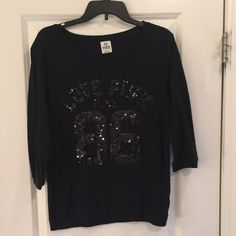 Lg PINK top Lg PINK top with black sequins. This is used and is in good condition but can tel the material has been washed. PINK Victoria's Secret Tops Tees - Short Sleeve