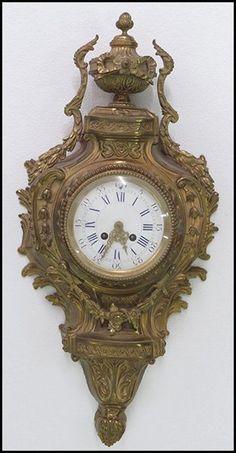 FRENCH GILT BRONZE CARTEL CLOCK. : Lot 1262248