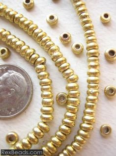 Brass Spacer Beads (4x3mm)A beautiful strand of approximately 280 Brass Beads from India on cord 23 inches long. Each Brass bead measures approximately 1/16 x 1/8 inches (3mm x 4mm). The hole measures 1+mm wide.
