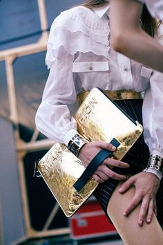 Gold envelope clutch and blouse backstage at Chanel SS15 PFW. More images here: http://www.dazeddigital.com/fashion/article/22030/1/chanel-ss15