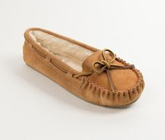 PRETTY AND POPULAR One of our most well-liked women's slippers, available in a variety of colors. The Cally Slipper by Minnetonka has a thin rubber outsole with a comfy pile lining to help keep feet a