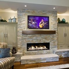 Stone fireplace design. TV central. White stepping stone. Any preference to open shelving on either side?  #stone #fireplace #shelving