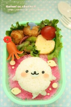 little seal mamegoma theme obento. I wonder how the pink layer is made under the seal ? could be done with some ketchup.