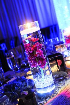 Centerpiece idea: Simple Vase with a Submersible LED light in the bottom and a floating candle on top. In the middle use water pearls and submerge fresh or faux flowers.