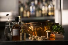 Copper Punch Bowl set, complemented by coordinated punch cups. Pre-measured ingredients are presented alongside the original bottles