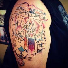Leonardo da Vinci's Vitruvian Man inspired abstract tattoo on the upper arm. By Alx Bizar.