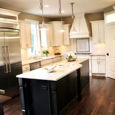 warm ivory cabinets, dark tan walls, paired with rich walnut floors .... nice