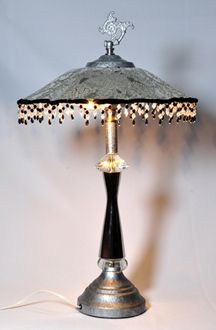 Glass shade lamp with mirror finish post and bead tasseled fringe. Aged silver and hexagon crystal