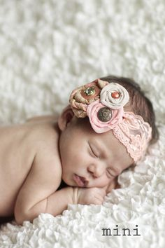 @April Parrish You could totally make these little flowers. I really love how the headband is lace. So feminine!