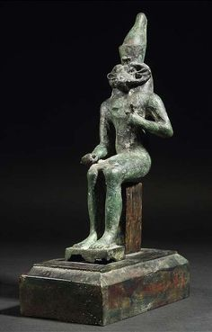 A bronze figure of an Egyptian God with ram horns, possibly Amun or Chnum. - Property of an old German aristocratic collection. - Crusty blackish-green patina, restored.