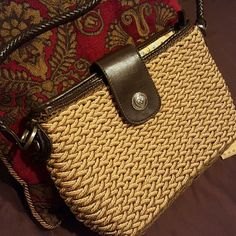 Perfect Purse Lots of space and organization slots one zipper pocket inside and it zips closed with leather snap and heart shape button very clean like new no wear or tear perfect strap is woven brown leather about 18 inches in length beautiful interior Elka Accessories Bags Shoulder Bags