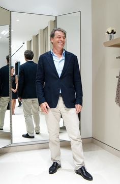 Charles of Judith and Charles at the opening of his newly renovated store at First Canadian Place.    Navy blazer, light blue dress shirt, khakis, black dress shoes, black belt