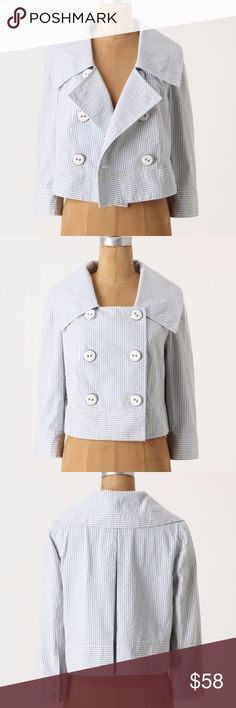 """Anthropologie DAUGHTERS OF THE LIBERATION Jacket Anthropologie Thursday Cropped Jacket by DAUGHTERS OF THE LIBERATION  This double-breasted seersucker jacket from Daughters of the Liberation is a modern southern charmer.  size 2  bust 36 length 18 sleeve 18 1/2 shoulder 15  blue+white  seersucker striped double breasted military, nautical style 3/4 sleeve cropped length back kick pleat swing fit lined  condition: excellent (remove tacking """"X"""" thread stitch from back pleat before wearing)…"""