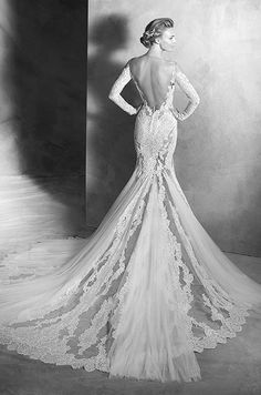 Tulle mermaid wedding dress with lace appliqués. Sheer illusion tulle bodice with long sleeves and lace appliqués. Atelier Pronovias, 2016
