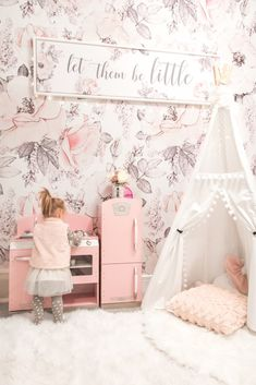 Glamorous pink kids playroom with pink floral peel and stick wallpaper - Using Our Glamorous Pink Playroom to Manage Toy Clutter • Chandeliers and Champagne