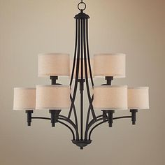 With two tiers, this 9-light chandelier features linen shades surrounded by an oil rubbed bronze finish frame.