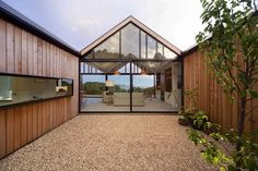 This Tasmanian home features a glass wall that overlooks a central courtyard.    This originally appeared in One-of-a-Kind Glass Facade Gives Tasmanian House Unforgettable Views.