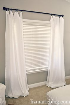 DIY Floor length curtains for cheap! - at lizmarieblog.com made from $10 tablecloths and $5 ring clips from Lowes