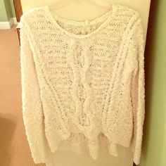 Anthropologie cream sweater! Anthropologie cream sweater! Never worn. Perfect condition. Size X-small. Lower in back then in front but not by much. Could easily fit a size small as well. Anthropologie Tops