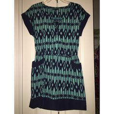 Teal Cute Casual Dress  CLOSET CLEAR OUT TODAY ONLYA black & teal dress! •Draw strings in the middle where the dress would plunge•two pockets•Elastic waste band•no zipper up the back• Size SMALL. GAP Dresses Asymmetrical