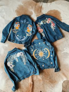Apr 2020 - Indigo blue DENIM AND BONE bridal jacket with intricate inspired gold embroidery. Perfect for the bohemian bride to be's engagement party, hen do or for Painted Denim Jacket, Painted Jeans, Painted Clothes, Embroidered Denim Jacket, Embroidered Clothes, Denim Jacket Embroidery, Embroidery On Clothes, Denim Art, Bohemian Bride