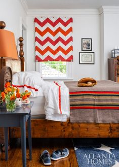 This teen bedroom nods to the family's love of sports, featuring signed memorabilia and a playful red-and-blue palette. The drapery fabric is Schumacher and the bedding is Peacock Alley. Dutch Colonial Homes, Antique Dining Chairs, Interior And Exterior, Interior Design, Blue Palette, Bedroom Images, Atlanta Homes, Color Stories, Kid Spaces