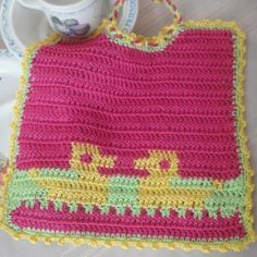Baby crochet patterns for beginners can often lead to amazing gifts. This is certainly the case for this Colorful Crochet Baby Bib. Use bright yarn colors like pink and yellow to make a completely unique piece that a new mommy will absolutely love.
