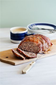 A delicious meatloaf is nice for a change from meatballs and beef patties. Here with bacon and herb spices.