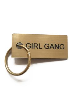 """GIRL GANG"" Key tag with gold colored split ring 2"" by 1/2"" Shipping Specifications Handmade in New York City. Please allow 5-7 business days for production. Re"