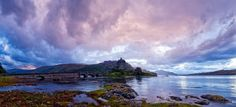 Panorama of stormy skies over Eilean Donan Castle.