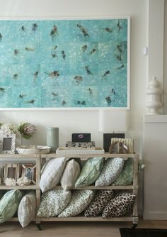 Look at the painting in the background -- could make a fun DIY project…...