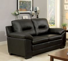 "Furniture of America Stewart Leatherette Love Seat, Black. Contemporary style love seat. Generously padded for comfort. Rich leatherette upholstery available in 3 colors. Sleek profile with wooden block feet. Overall dimensions: 60""l x 37""w x 39""h (seat depth: 22""; seat height: 20"")."