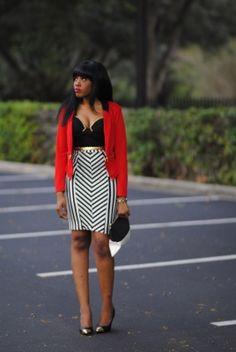 Black and white striped skirt, red blazer.