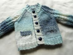 Baby boy sweater in shades of blue.