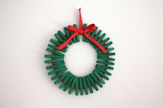 Christmas card holder - clothespins, wire hanger, beads and ribbon.