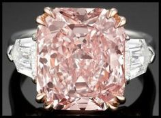 carat type IIa fancy pink diamond flanked on either side by two sheild or bullet-cut diamonds, totaling carats and both graded E color and clarity. Via Diamonds in the Library. - Diamonds in the Library Diamond Rings, Diamond Engagement Rings, Diamond Jewelry, Diamond Cuts, Solitaire Engagement, Gems Jewelry, I Love Jewelry, Jewlery, Jewelry Gifts