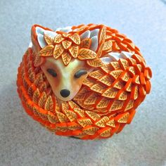 https://flic.kr/p/B1UagJ | Sleeping Fox Box by Deb Hart | Ok - I started on this one a long time ago and just didn't know how I wanted to finish it so have been playing around. I finally found what I was looking for and YES this is a box. I still have a bed of flowers, grass and leaves to make, but I'm hoping to release this as a new class on CraftArtEdu in the next few months.