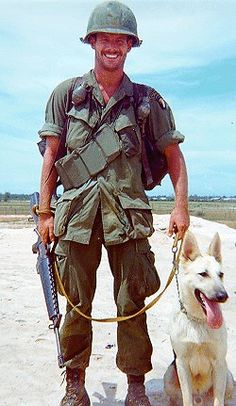 A human and canine pair of the 47th Scout Dog Platoon.